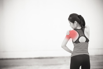fitness woman having pain in shoulder
