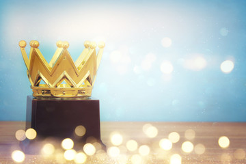 image of golden crown award over wooden table