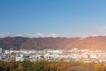City of Osaka with mountain during autumn season, Japan