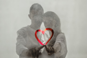 Lovers draw a heart on the glass. Love.