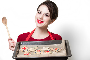 young housewife with gingerbread cookie