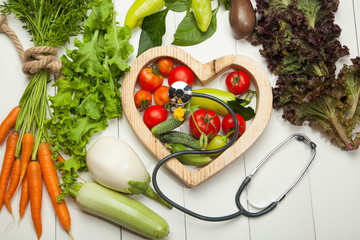 Fresh vegetables in the heart on a white background. Diet, a healthy lifestyle.