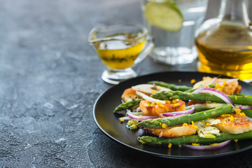 Salad with fried halloumi, asparagus and orange zest. Copy space