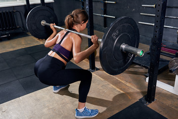 Back View of Woman in Shoulder Squat