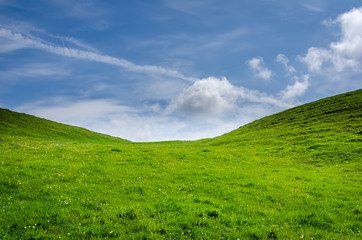 Green hill and a blue sky Wall mural