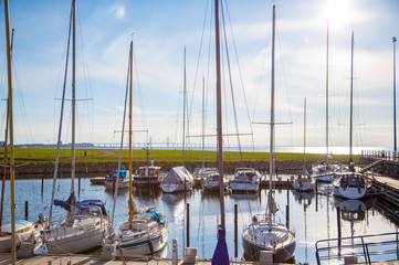 Yachts docked by the canal with a view on the Oresund bridge