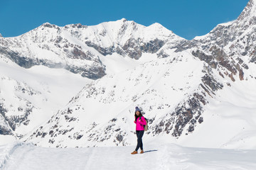 an asian young woman traveling on the snow mountain