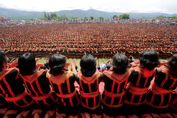 People, including police and military, take part in a traditional Saman dance which originates from the Gayo ethnic group in Gayo Lues District, Aceh province
