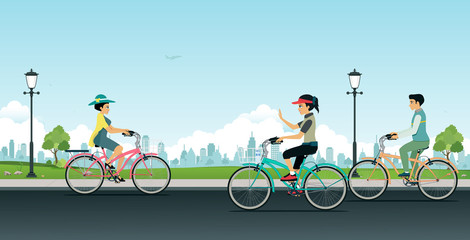 Men and women are riding bicycles in gardens with city backdrops.
