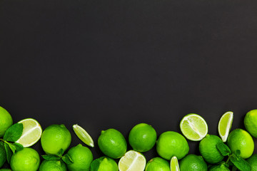 Fresh lime on a black background& Top view. Free space.