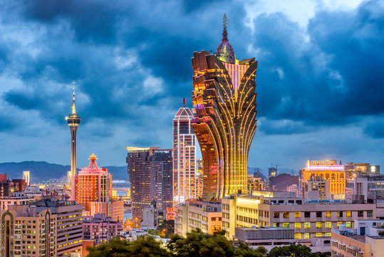 Macau, China city skyline at dusk.