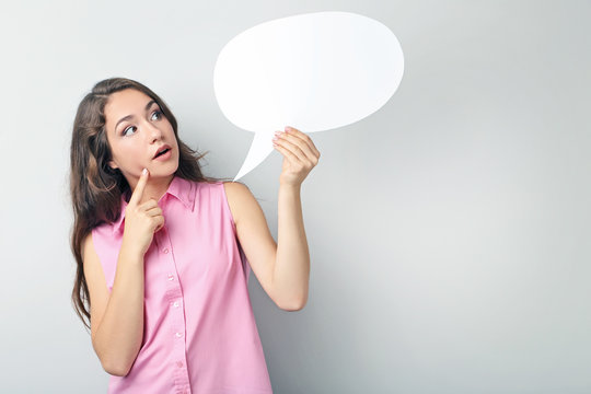 Young woman with speech bubble on grey background