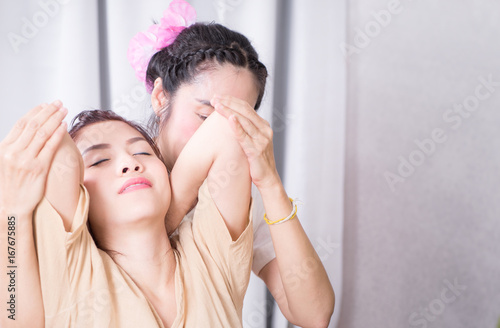 Women is getting arm Stretching in a Thai massage course