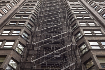 Looking up the fire escape of a classic building