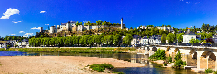Landmarks of France - panoramic view of Chinon with royal castle. Loire valley river