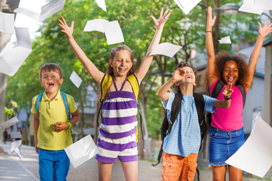 Cool kids throw papers in the air from excitement