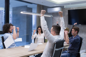 startup Group of young business people throwing documents
