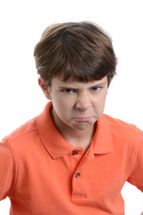 boy with mad facial expression isolated white background