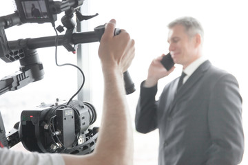 Videographer making video of businessman