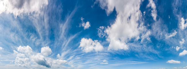 gorgeous cloudscape panorama on a blue summer sky