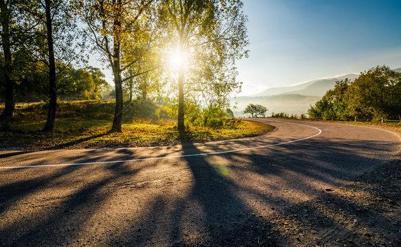 mountainous countryside road at sunrise