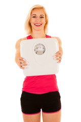 active sporty woman holds a scale as she lost weight