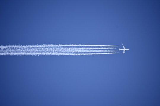 A jet plane leaving a condensation trail