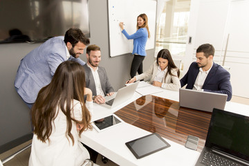 Team of young colleagues working together in an office