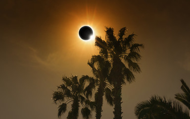 Total solar eclipse in dark glowing sky