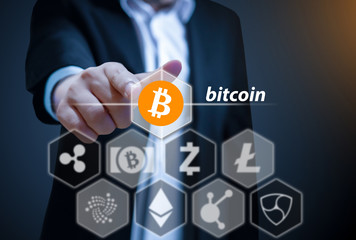 Business man points his finger at Bitcoin icon, Concept of  Cryptocurrency, a digital currency
