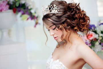 Portrait of beautiful bride in wedding dress