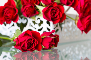 Romantic red roses on table