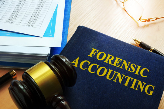Book with title forensic accounting on a table.