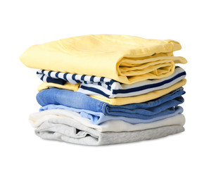 Folded stack clothes isolated on white.
