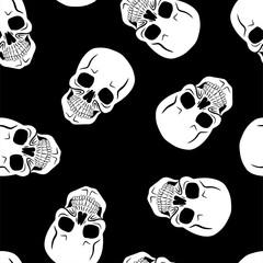 Skulls on black background. Seamless pattern. Vector illustration
