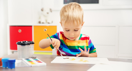 Little child drawing on the paper