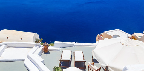 Sunbed on terrace. White architecture on Santorini island, Greece. Beautiful view on the sea