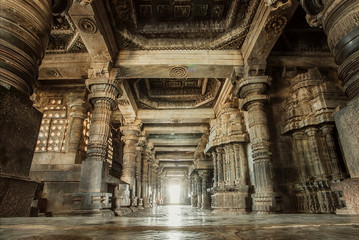 Wall Murals Place of worship Columns and empty corridor inside the 12th century stone temple Hoysaleswara, now Karnataka state of India