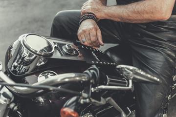 Man ready for trip on motorbike