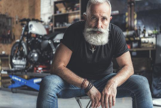 Interested old man in garage