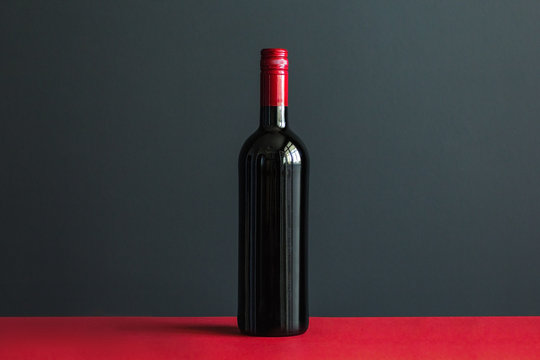 Bottle of wine on red table