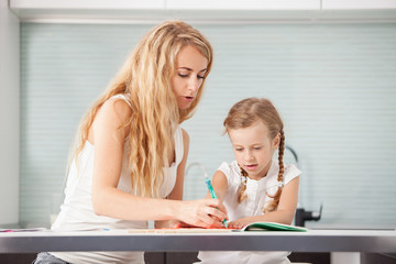 Parent teaches a child to write