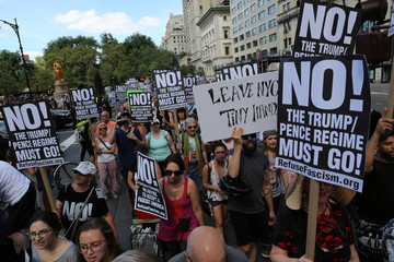 Protesters march and chant slogans against white nationalism in Times Square in New York City