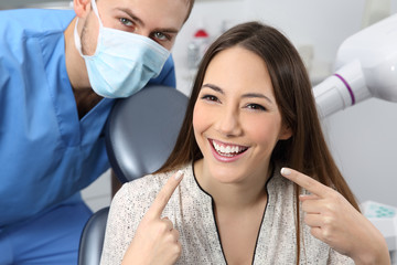 Satisfied dentist patient showing her perfect smile