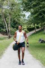 Muscular black man walking in park