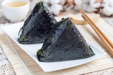 Korean triangle kimbap Samgak with nori, rice and tuna fish, similar to Japanese rice ball onigiri. Horizontal