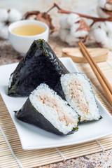 Korean triangle kimbap Samgak with nori, rice and tuna fish, similar to Japanese rice ball onigiri. Vertical
