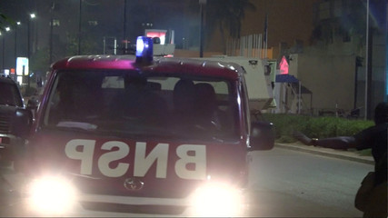 An armoured vehicle opens fire in the direction of a restaurant following an attack by gunmen on the restaurant in Ouagadougou, Burkina Faso, in this still frame taken from video