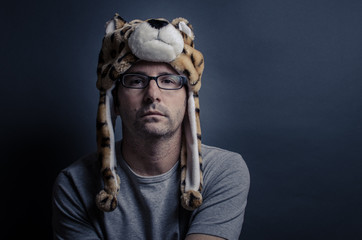 Young Man in Glasses Wearing a Tiger Head Hat