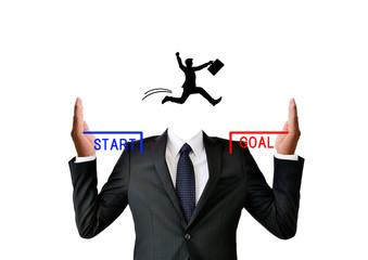 成功のイメージを掲げるビジネスマン
